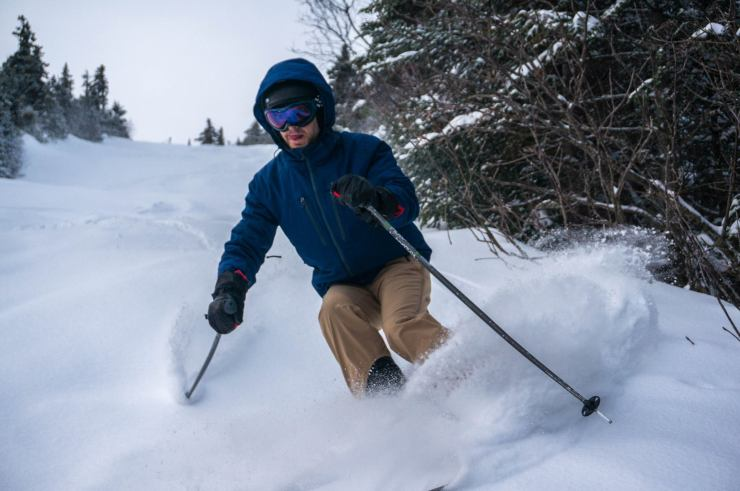 Intern Kory at Sunday River making a sweet turn in fresh powder for a photo